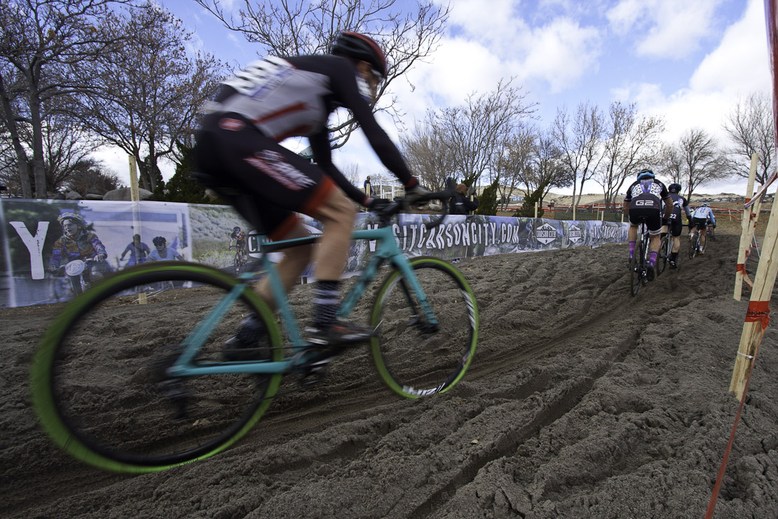 Cyclocross racer riding in sand
